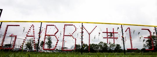 Memorial items for Gabriella Christine Rodriguez, 15, a Western Hills University High School student, are hung on the softball field fence at her school. Rodriquez was killed after being struck by a vehicle on the 2100 block of Harrison Avenue.