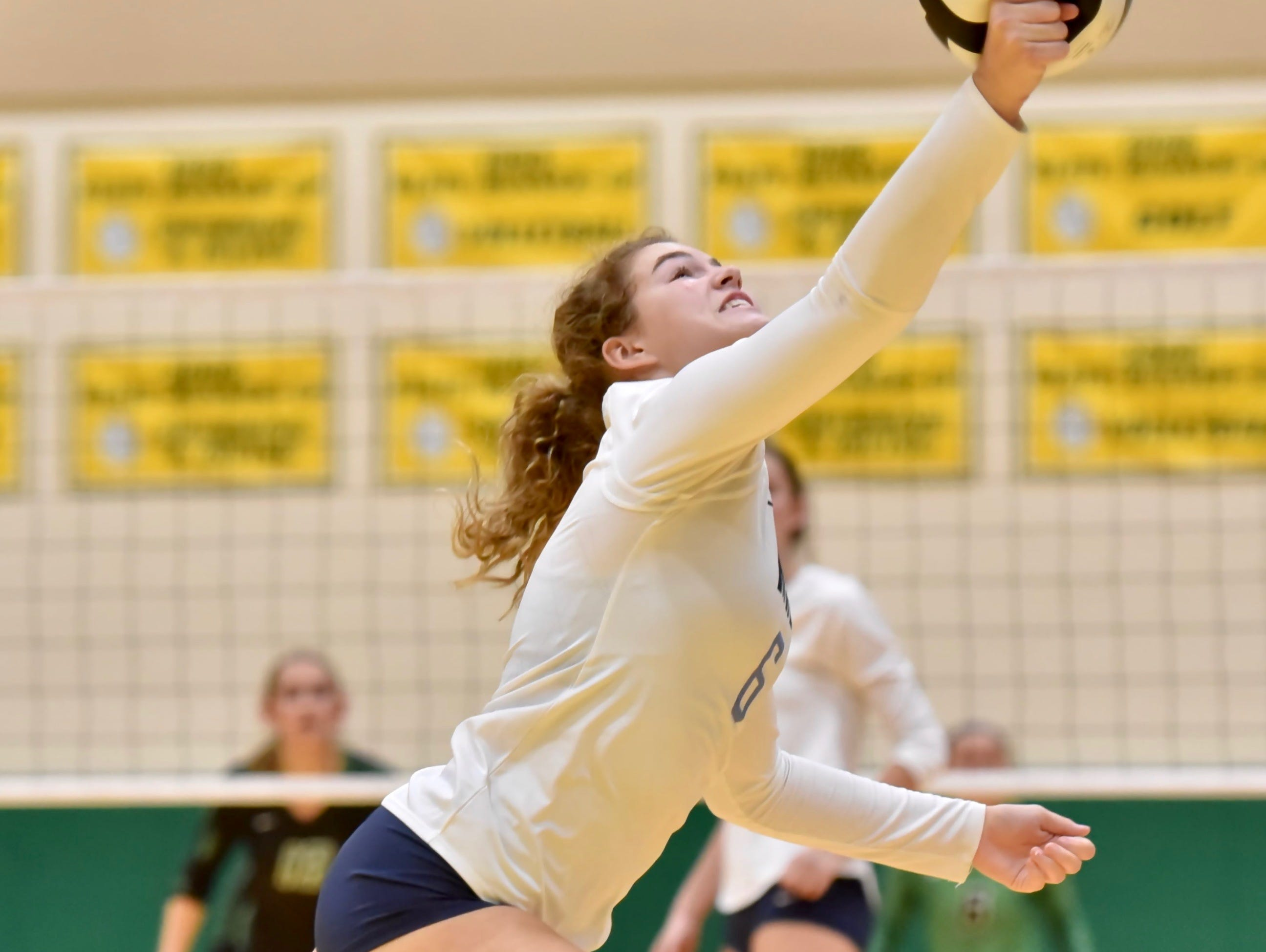 Mount Notre Dame's Ally Christman dives for a ball against Ursuline Tuesday, Sept. 11, 2018 at Ursuline Academy