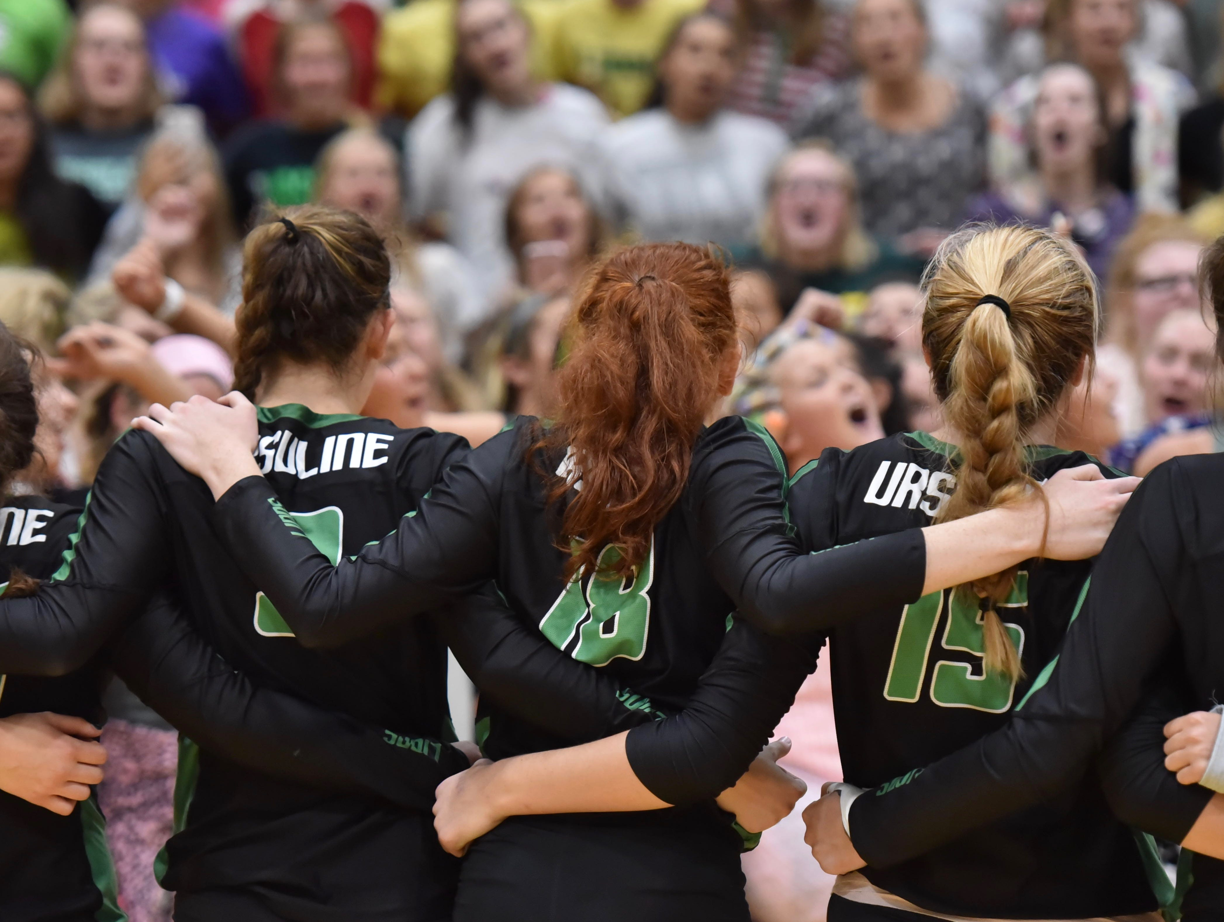 The Ursuline players celebrate with the students after defeating Mount Notre Dame three sets to twoTuesday, Sept. 11, 2018 at Ursuline Academy