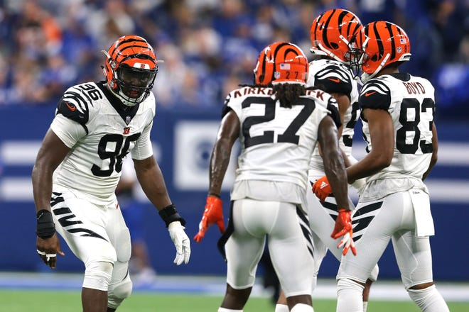Cincinnati Bengals defensive end Carlos Dunlap (96), left, and Cincinnati Bengals defensive back Dre Kirkpatrick (27) react to a sack in the third quarter during the Week 1 NFL game between the Cincinnati Bengals and the Indianapolis Colts, Sunday, Sept. 9, 2018, at Lucas Oil Stadium in Indianapolis. Cincinnati won 34-23.
