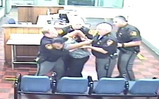 Video captured deputies struggling with Kassandra Jackson after Magistrate Michael Bachman sentenced her to jail time.