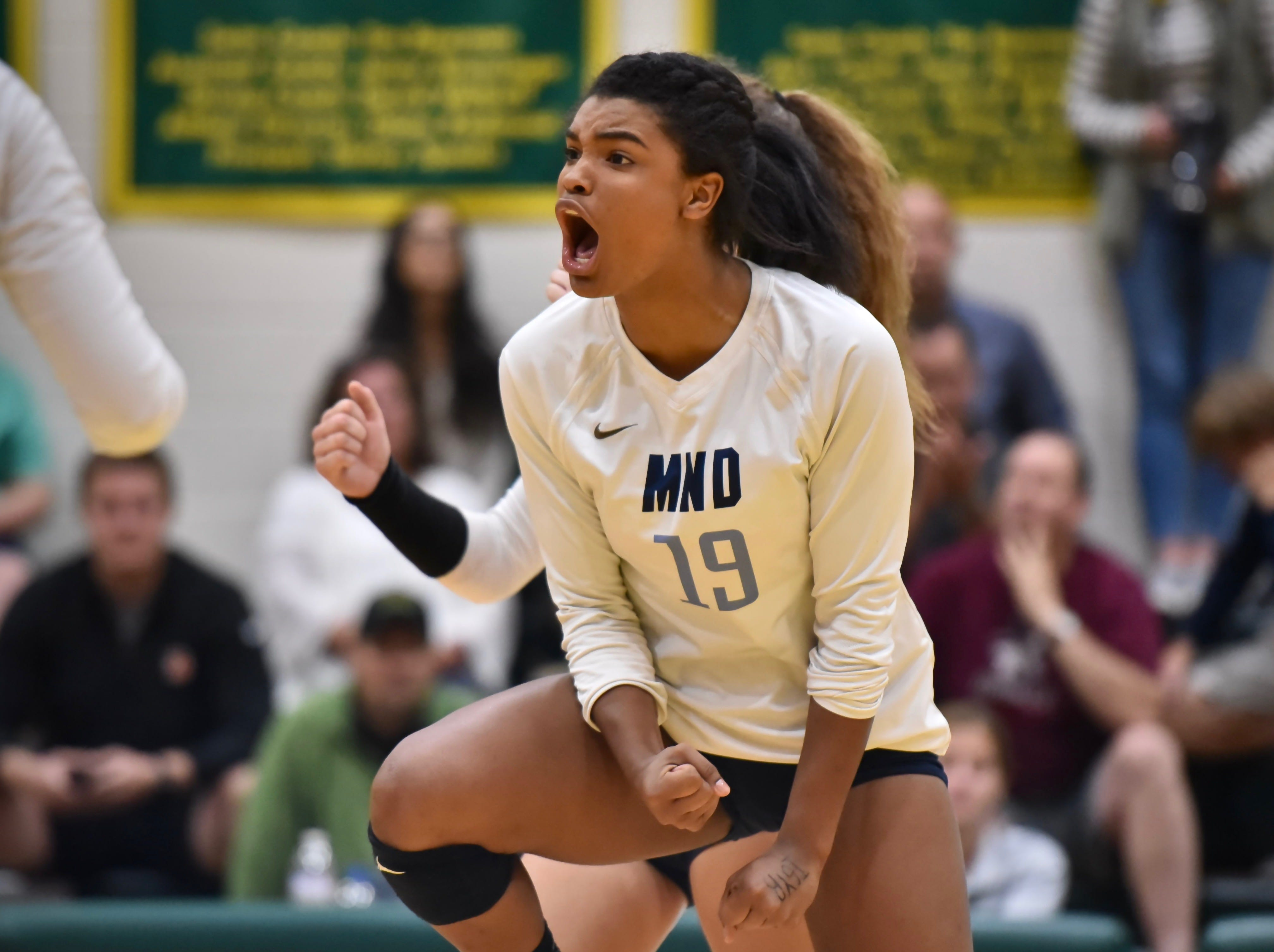 Mount Notre Dame's Ramei Jackson celebrates after spiking the ball for a point late in the fourth set against Ursuline Tuesday, Sept. 11, 2018 at Ursuline Academy