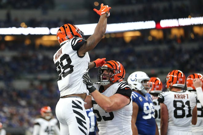 Cincinnati Bengals running back Joe Mixon (28) is lifted up by Cincinnati Bengals center Billy Price (53) after scoring a touchdown in the fourth quarter during the Week 1 NFL game between the Cincinnati Bengals and the Indianapolis Colts, Sunday, Sept. 9, 2018, at Lucas Oil Stadium in Indianapolis. Cincinnati won 34-23.