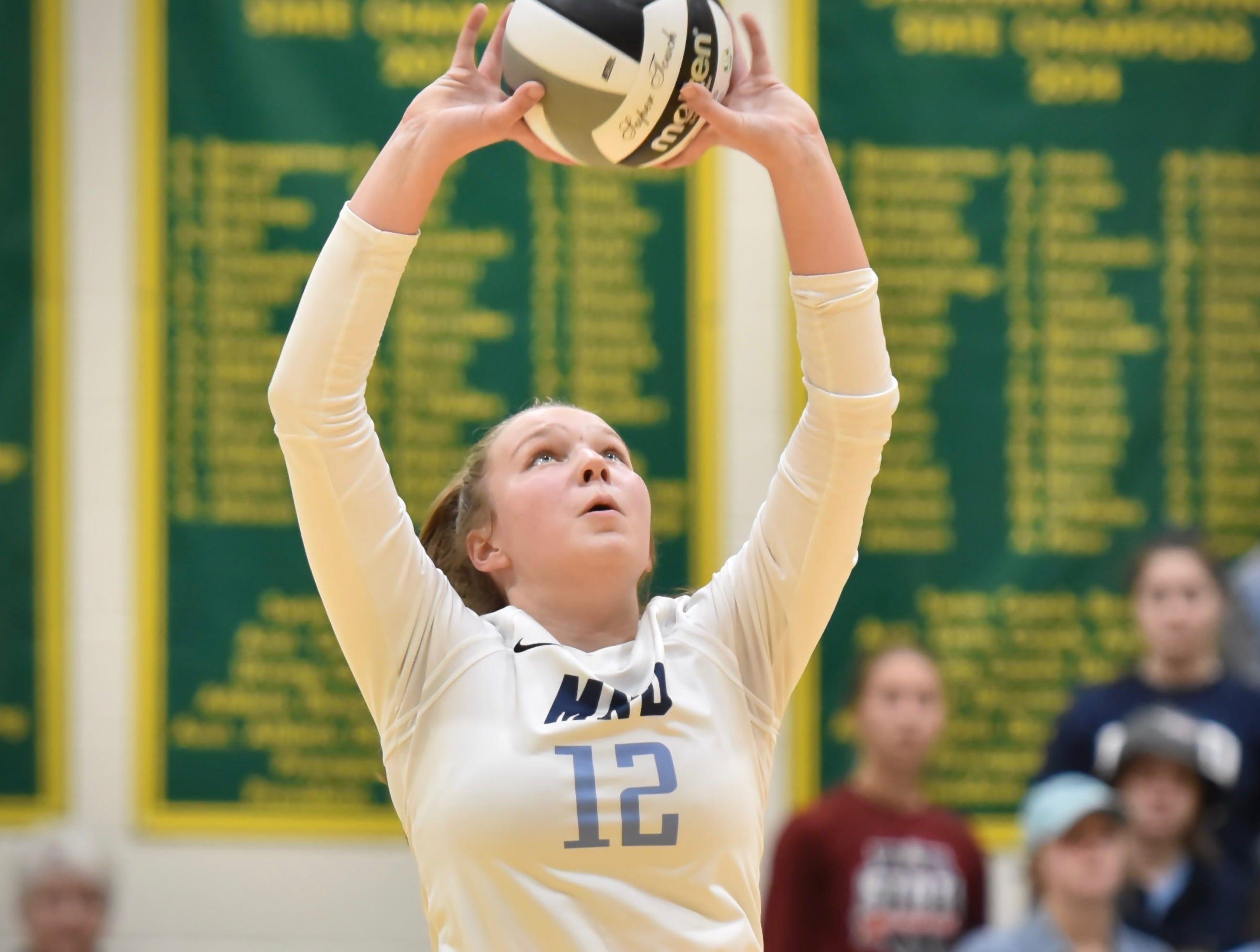 MND's Megan Wielonski sets a teammate against Ursuline Tuesday, Sept. 11, 2018 at Ursuline Academy