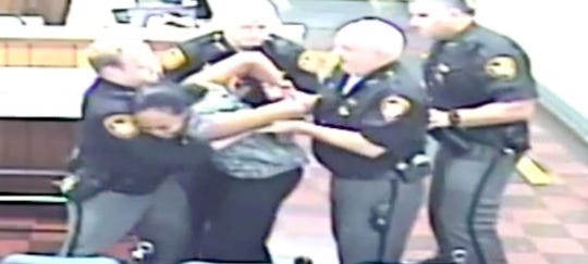 Video captured deputies struggling with Kassandra Jackson after her confrontation with Magistrate Michael Bachman.