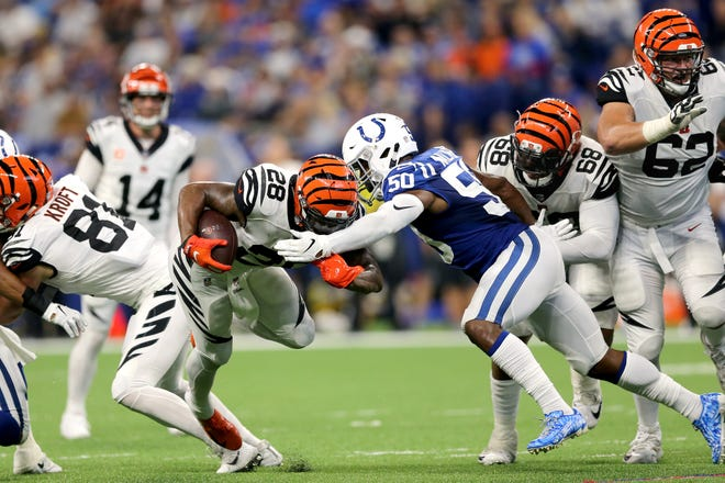 Cincinnati Bengals running back Joe Mixon (28), center, carries, the ball as Cincinnati Bengals offensive tackle Bobby Hart (68), right, tries to block in the fourth quarter during the Week 1 NFL game between the Cincinnati Bengals and the Indianapolis Colts, Sunday, Sept. 9, 2018, at Lucas Oil Stadium in Indianapolis. Cincinnati won 34-23.