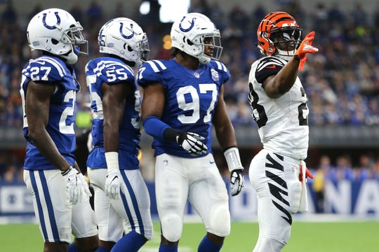 Cincinnati Bengals running back Joe Mixon (28) signals for a first down in the fourth quarter during the Week 1 NFL game between the Cincinnati Bengals and the Indianapolis Colts, Sunday, Sept. 9, 2018, at Lucas Oil Stadium in Indianapolis. Cincinnati won 34-23.