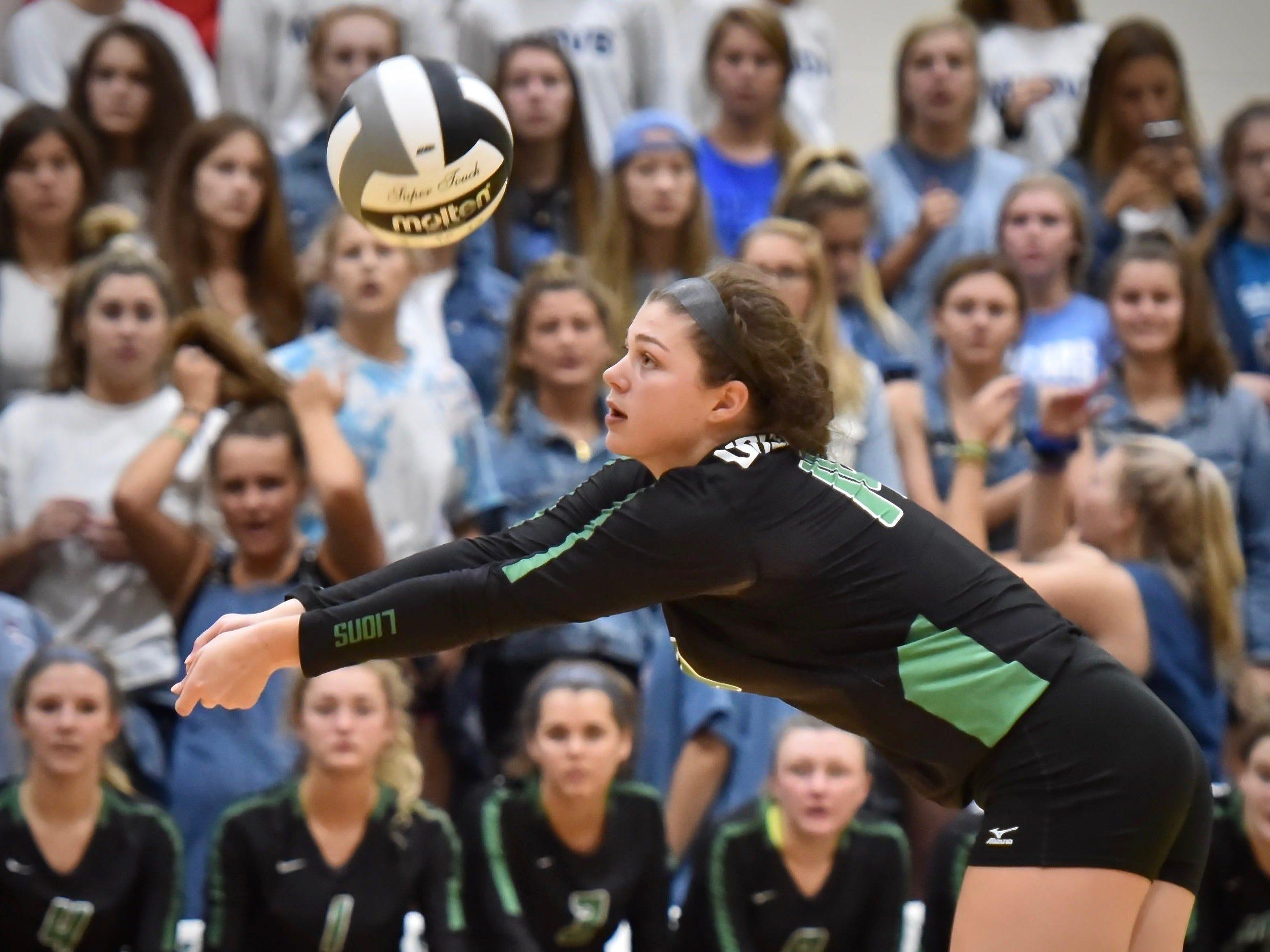 Ursuline's Andrea Elsbrock keeps a volley going against Mount Notre Dame Tuesday, Sept. 11, 2018 at Ursuline Academy