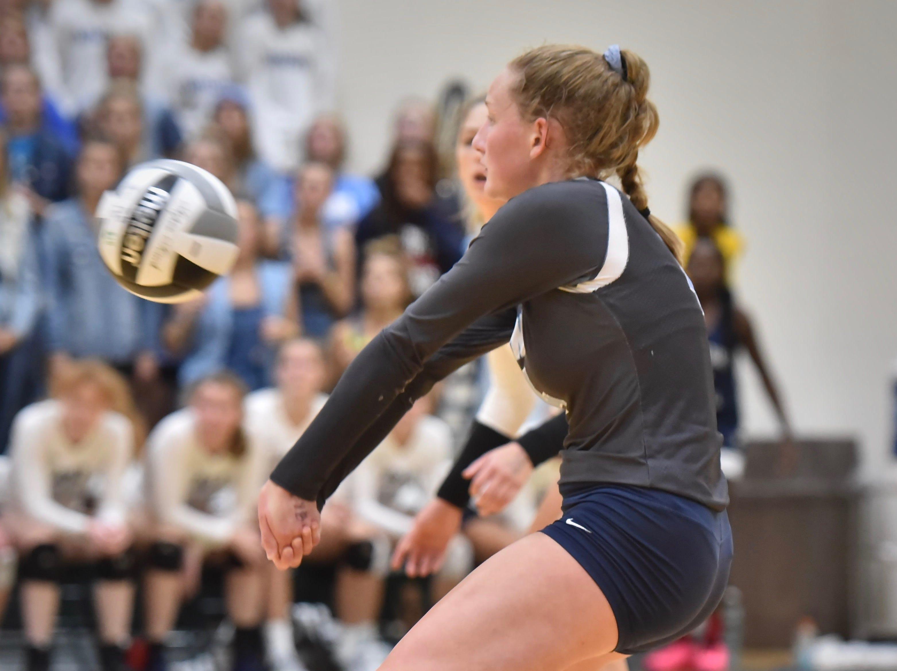 Mount Notre Dame's Emily Ernst returns a serve against Ursuline Academy Tuesday, Sept. 11, 2018 at Ursuline Academy