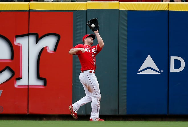 Cincinnati Reds right fielder Scott Schebler (43) catches a fly ball off the bat of Los Angeles Dodgers center fielder Enrique Hernandez (14) in the ninth inning of the MLB National League game between the Cincinnati Reds and the Los Angeles Dodgers at Great American Ball Park in downtown Cincinnati on Wednesday, Sept. 12, 2018.
