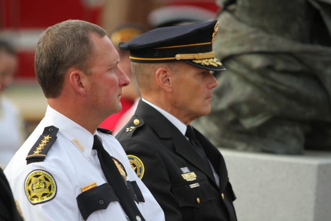 Montgomery County Sheriff John Fuson and Clarksville Police Chief Al Ansley attend the Clarksville Fire Rescue 9/11 Memorial Ceremony on Sept. 11. Under consolidation, the police chief would become a chief deputy in the sheriff's office.