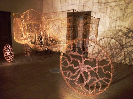 """Lieve Jerger, """"Carriage of Lost Love,"""" life size lace carriage woven  from copper wire"""