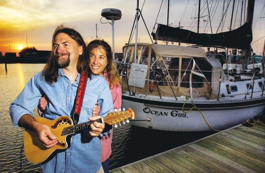 Mike and Amy Aiken at Rebel Marine dock near their sailboat, Ocean Girl. They sail the world, making music and seeing the sights. From Sept. 20 to 22, they will return to Raritan Valley Community College in Branchburg for the Aiken & Friends Music Fest.
