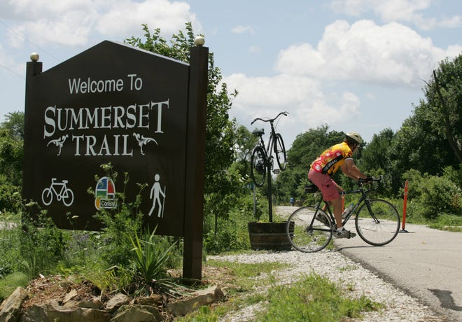 Mike Schiling of Springfield, Mo., takes off onto the Summerset Trail in 2008. The 11-mile trail runs from Carlisle to Indianola.