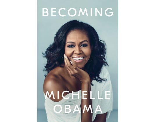 """This cover image released by Crown shows """"Becoming"""" by Michelle Obama, available on Nov. 13. Obama will visit 10 cities to promote her memoir, including Detroit."""