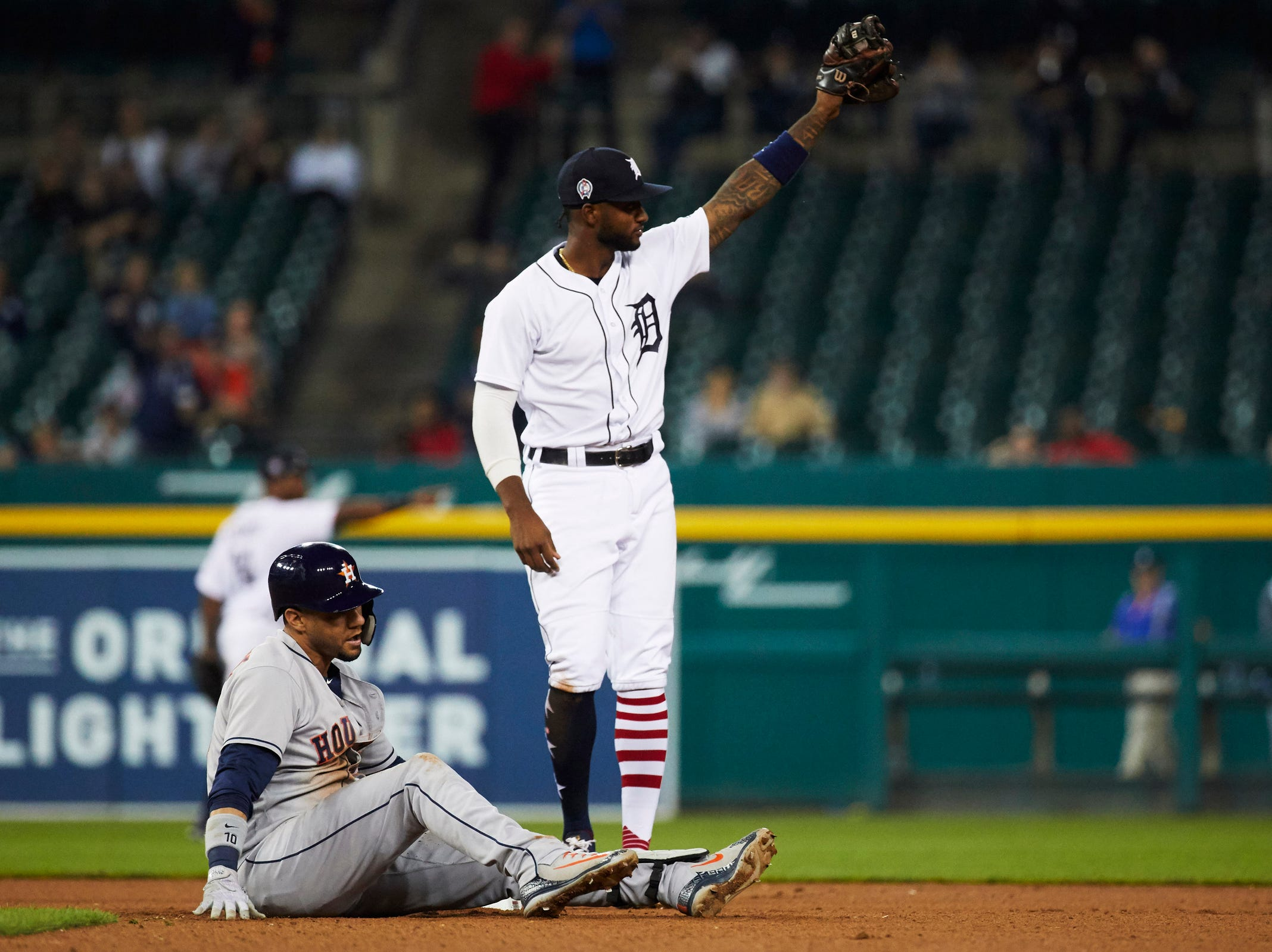 Detroit Tigers shortstop Niko Goodrum (28) points out towards center fielder JaCoby Jones (not pictured) after he throws out Houston Astros first baseman Yuli Gurriel (10) during the ninth inning at second during the ninth inning at Comerica Park, Tuesday, Sept. 11, 2018.
