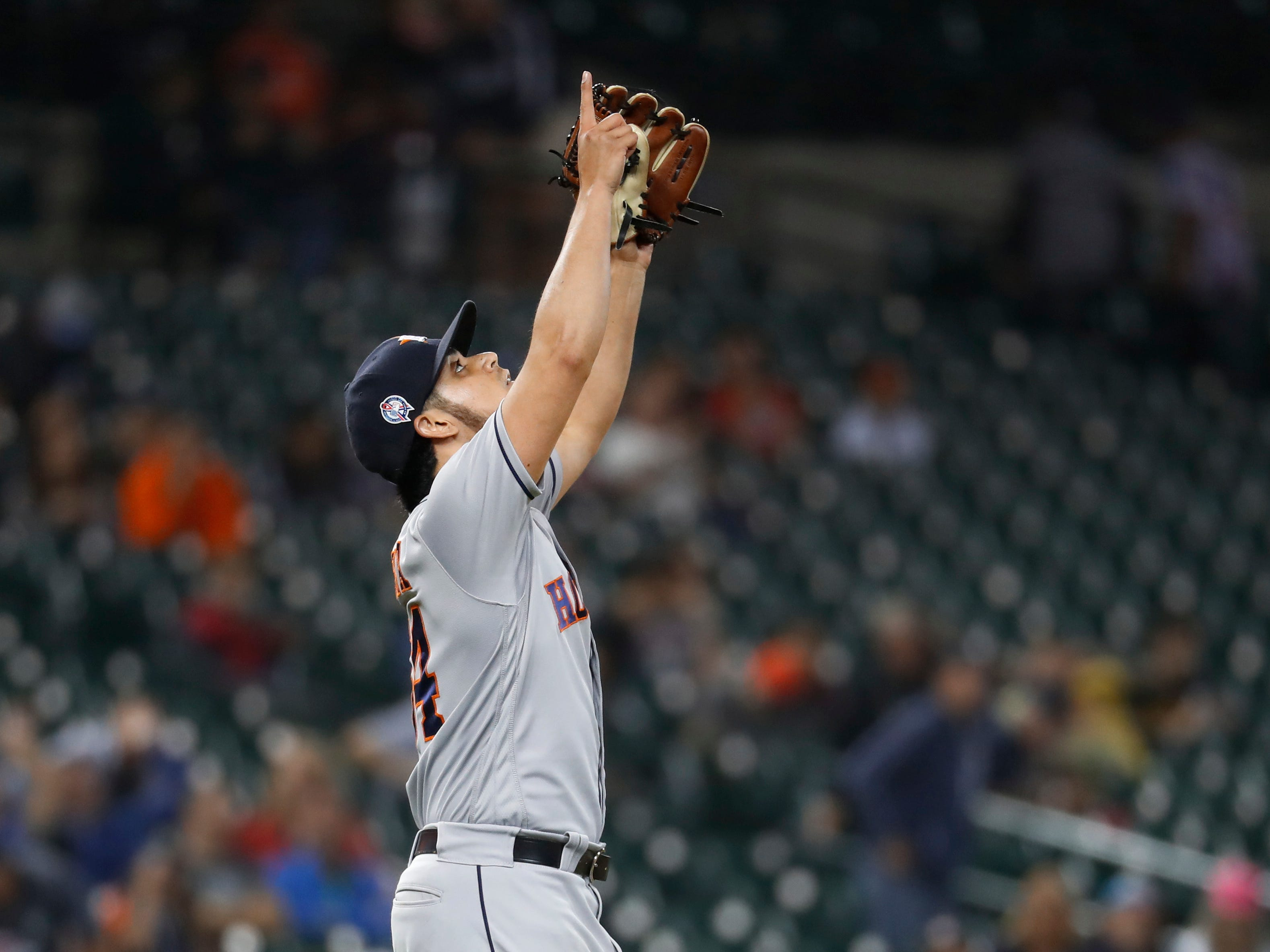Houston Astros relief pitcher Roberto Osuna celebrates the final out in the ninth inning of a baseball game against the Detroit Tigers in Detroit, Tuesday, Sept. 11, 2018. Houston won 5-4.