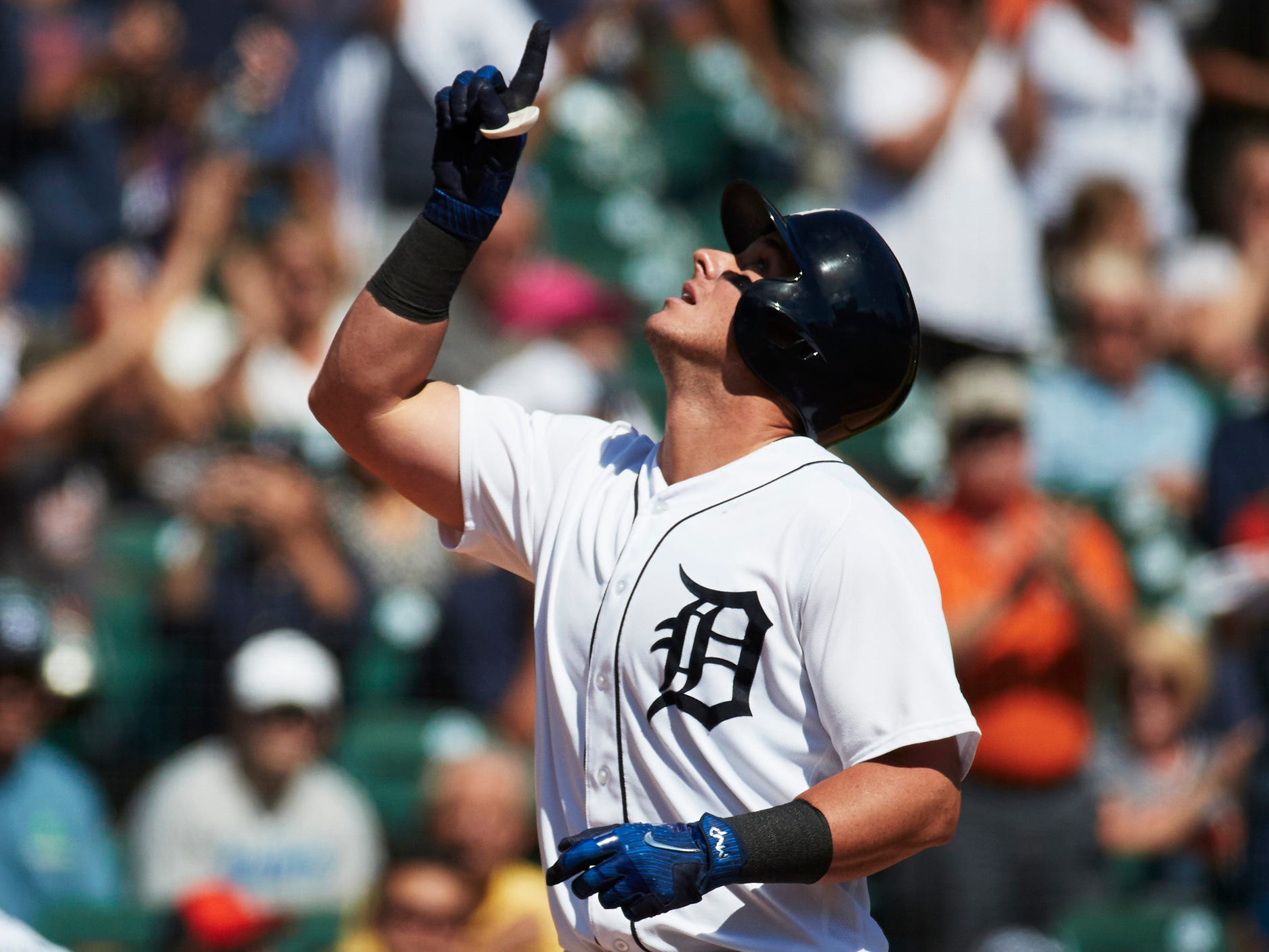 Tigers catcher James McCann celebrates after hitting a home run in the fourth inning of the Tigers' 5-4 loss to the Astros on Wednesday, Sept. 12, 2018, at Comerica Park.