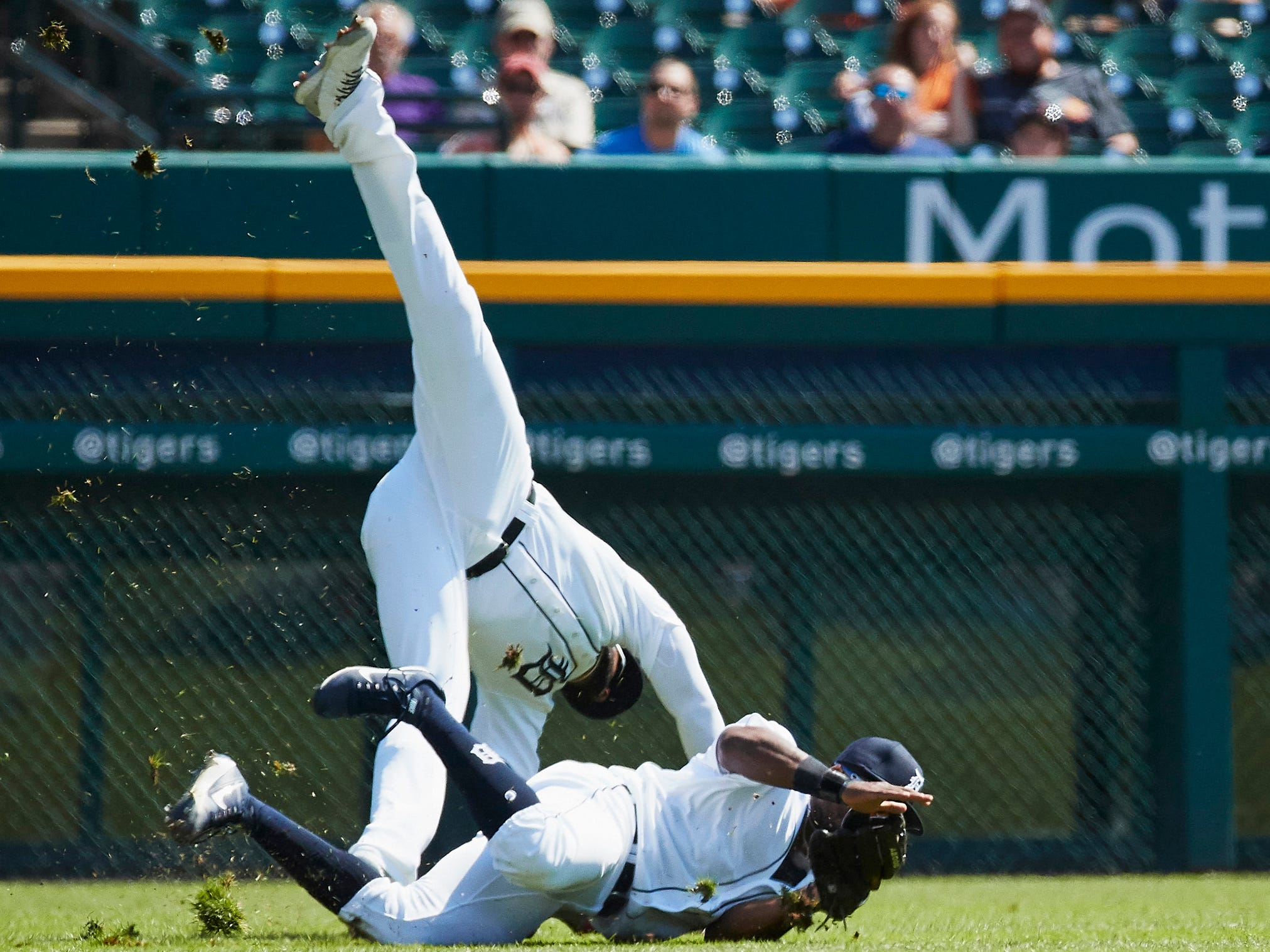 Tigers shortstop Niko Goodrum leaps over a sliding left fielder Christin Stewart during the second inning on Wednesday, Sept. 12, 2018, at Comerica Park.