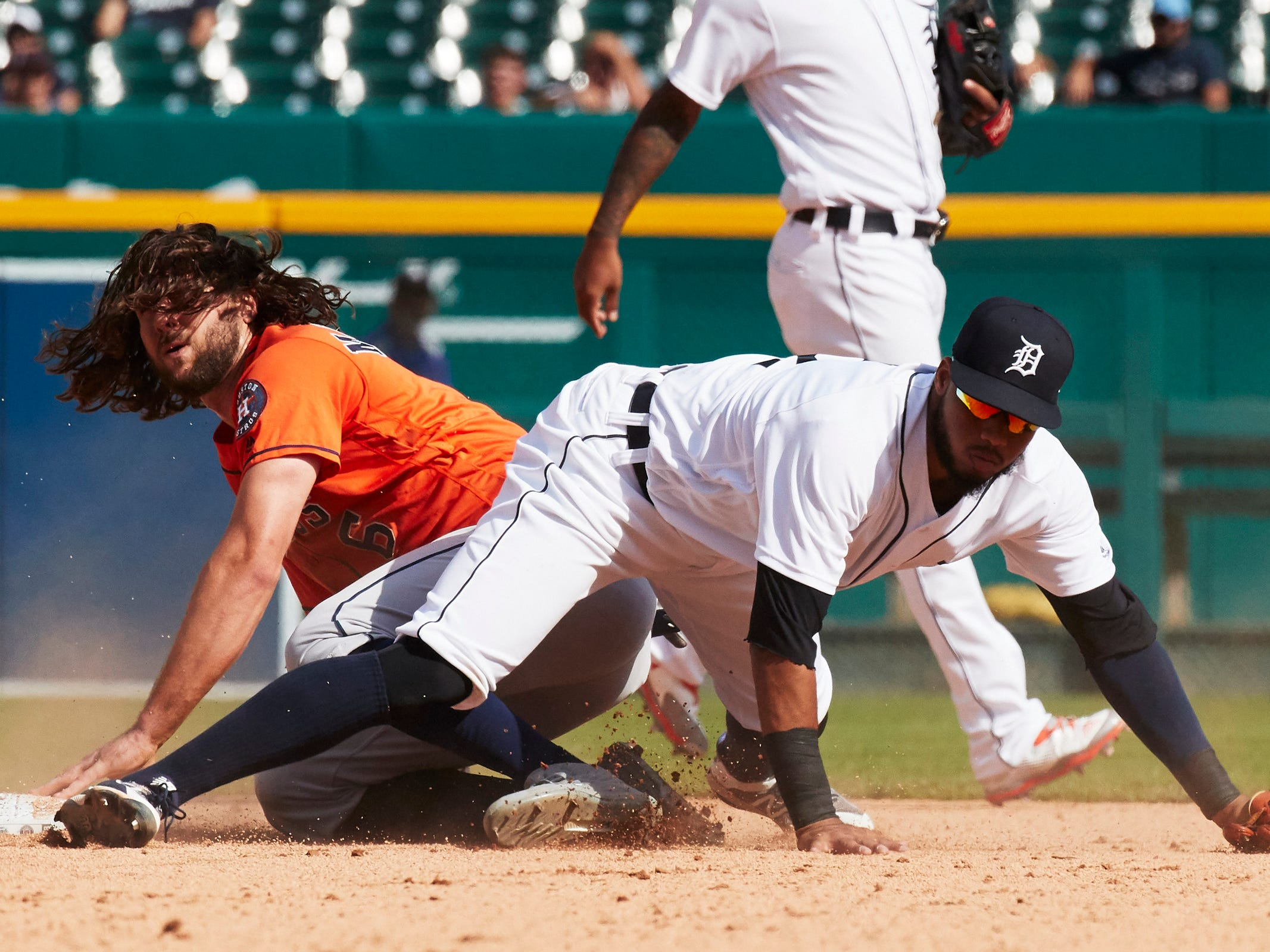 Astros center fielder Jake Marisnick is tagged out by Tigers second baseman Dawel Lugo while trying to steal second in the ninth inning of the Tigers' 5-4 loss tot he Astros on Wednesday, Sept. 12, 2018, at Comerica Park.