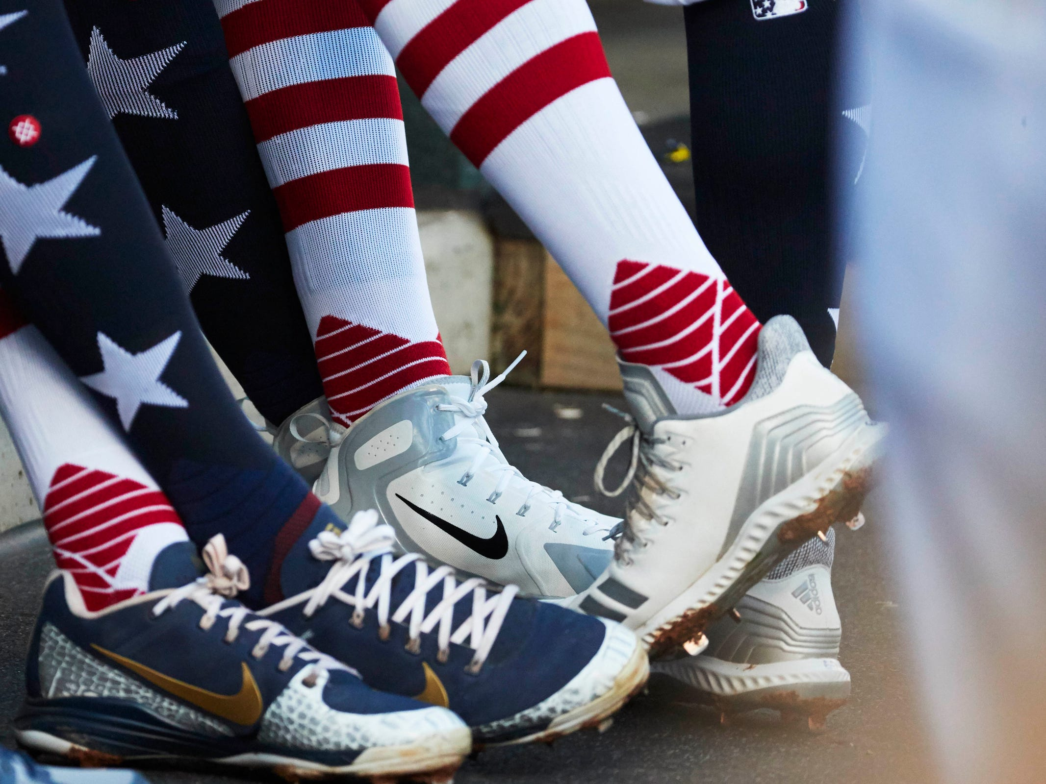 Detroit Tigers players wear stars and stripes socks in the dugout during the first inning against the Houston Astros at Comerica Park, Tuesday, Sept. 11, 2018.