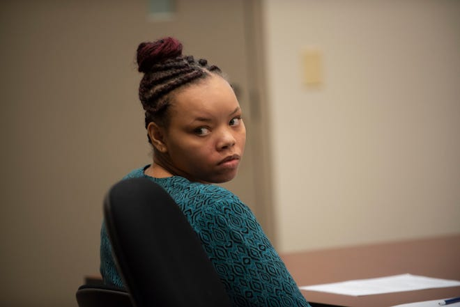 In a Tuesday, Sept. 4, 2018, photo, defendant Lovily Johnson appears in court for her trial in Grand Rapids, Mich. In 2017, Johnson brought her deceased baby to DeVos Children's Hospital.  Police said that Johnson, 22, admitted to leaving her baby alone for days while she hung out with friends and smoked pot. She was charged with murder and child abuse.