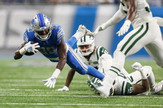 Detroit Lions running back Kerryon Johnson is tackled by the New York Jets during the first half at Ford Field in Detroit, Monday, Sept. 10, 2018.