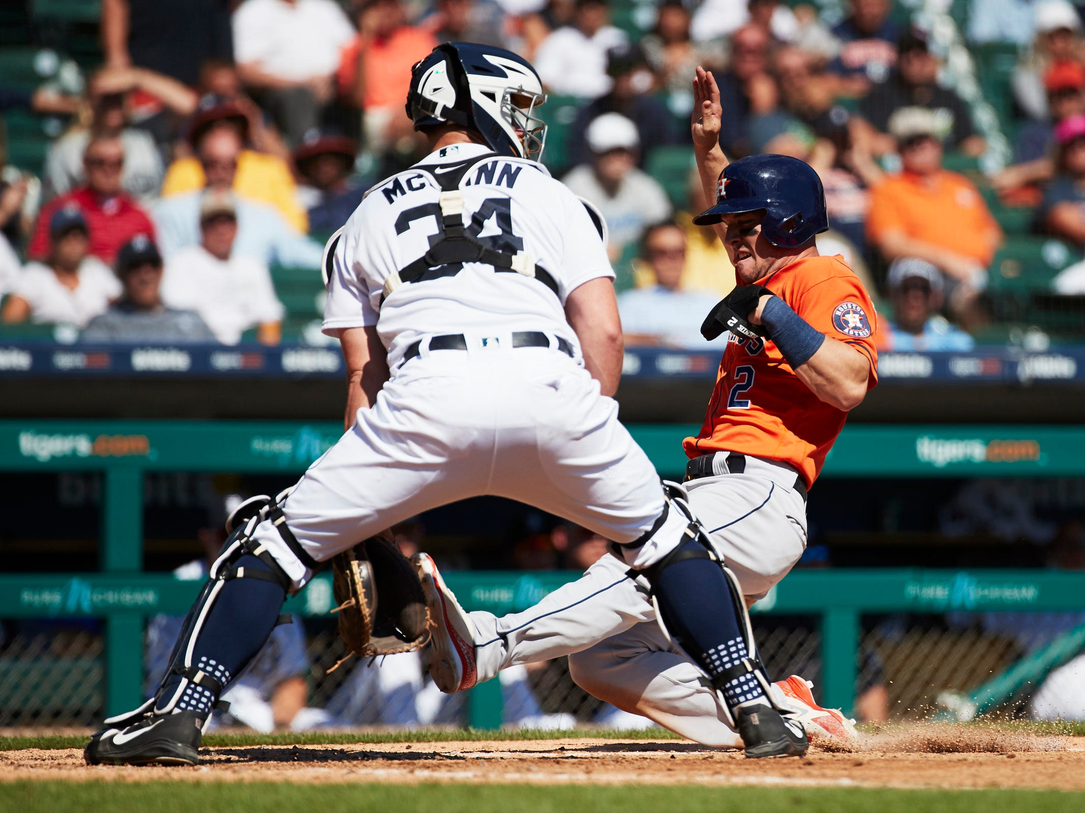 Astros third baseman Alex Bregman (2) slides in safe at home ahead of the throw to Tigers catcher James McCann in the fifth inning on Wednesday, Sept. 12, 2018, at Comerica Park.
