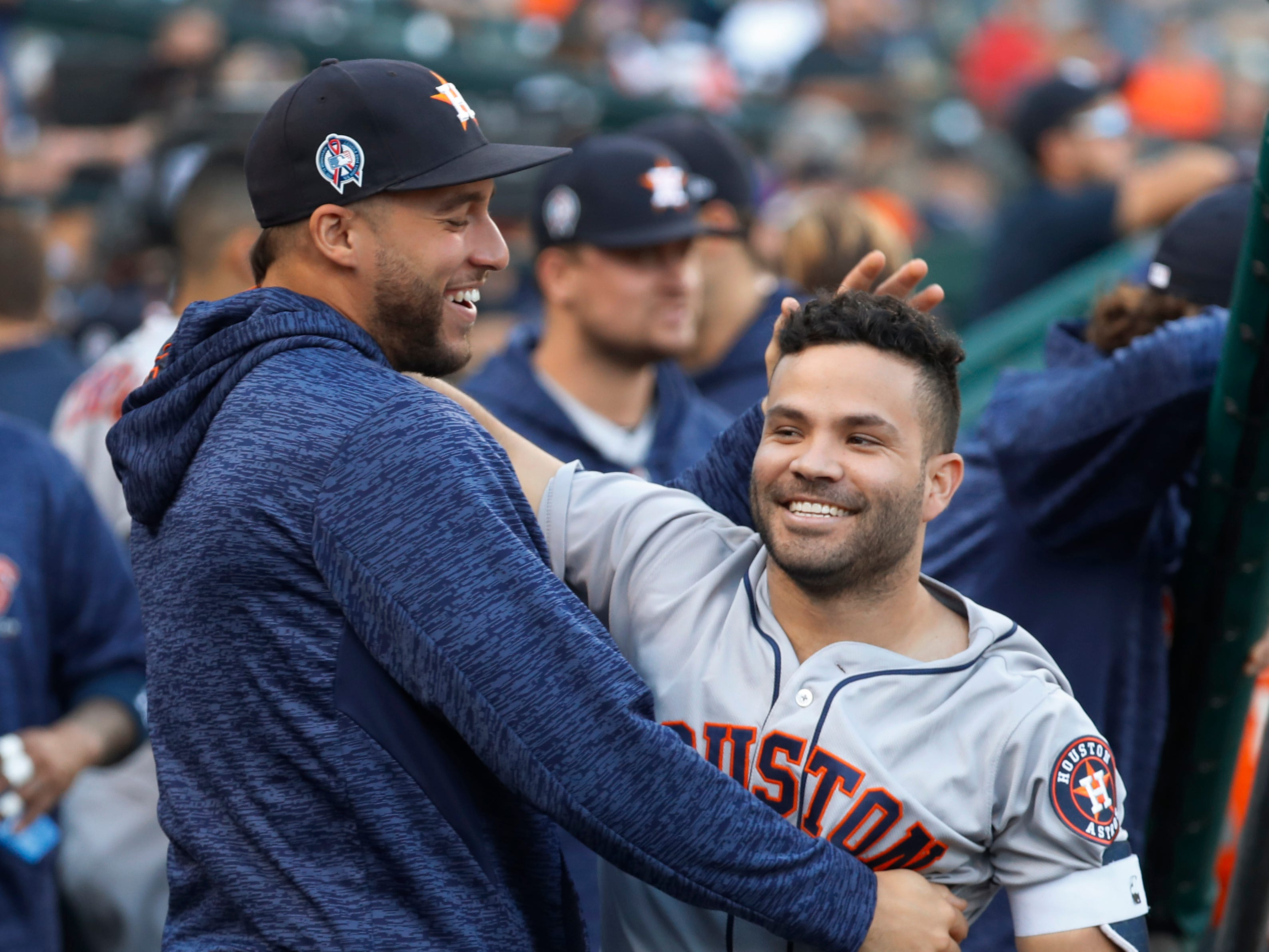 Houston Astros' Jose Altuve, right, celebrates his leadoff solo home run with George Springer in the first inning of a baseball game against the Detroit Tigers in Detroit, Tuesday, Sept. 11, 2018.