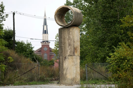 """Detroit Artist Scott Hocking, 43, says he used a telescopic handler to position discarded sewage pipes to make his art installation, """"17 Shitty Mountains,"""" in these abandoned public streets on Riopelle, Scott, and Eliot in Eastern Market as a part of the Murals in the Market in Detroit, photographed on Wednesday, Sept. 12, 2018."""