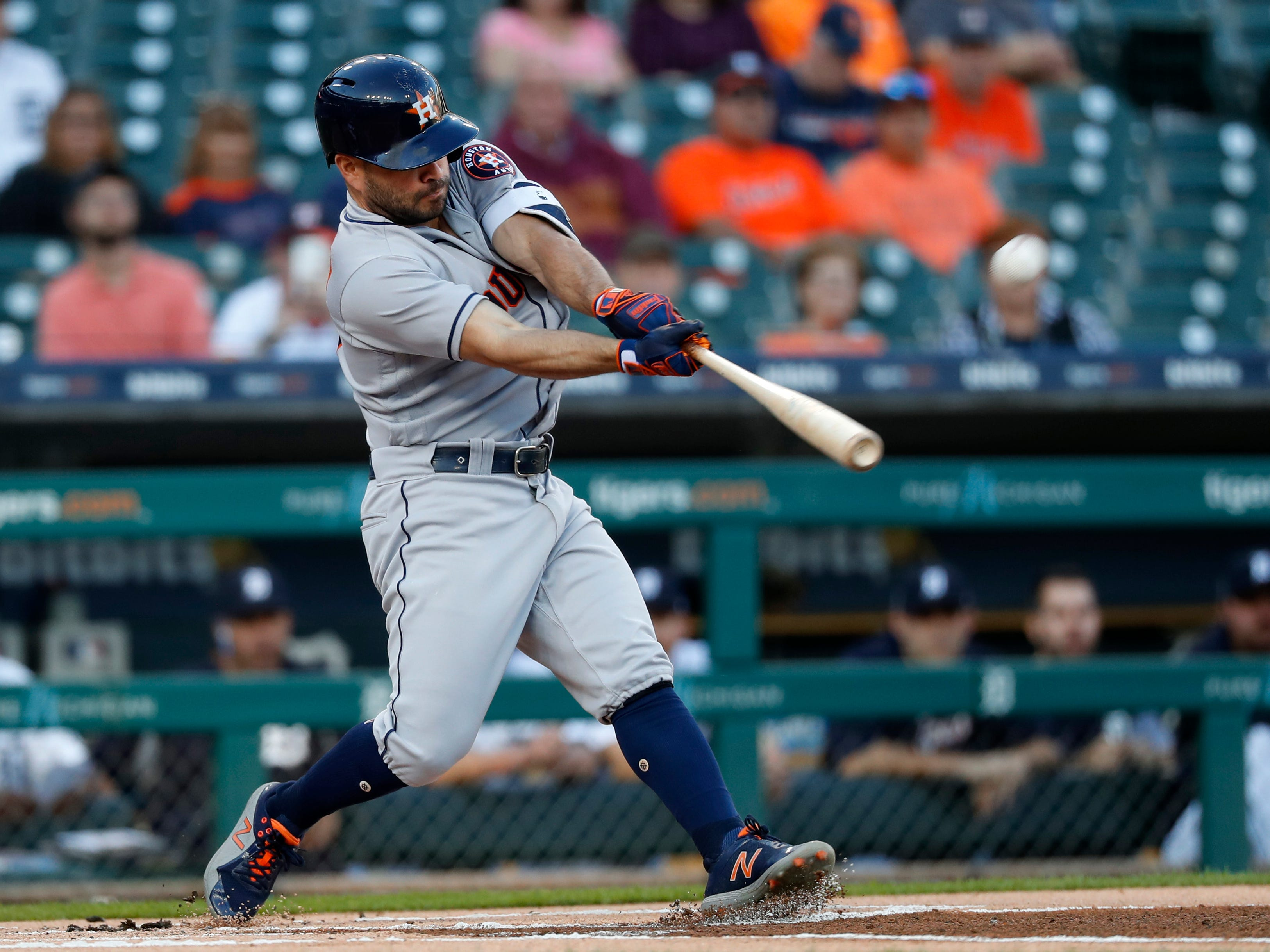 Houston Astros' Jose Altuve hits a leadoff solo home run against the Detroit Tigers in the first inning of a baseball game in Detroit, Tuesday, Sept. 11, 2018.