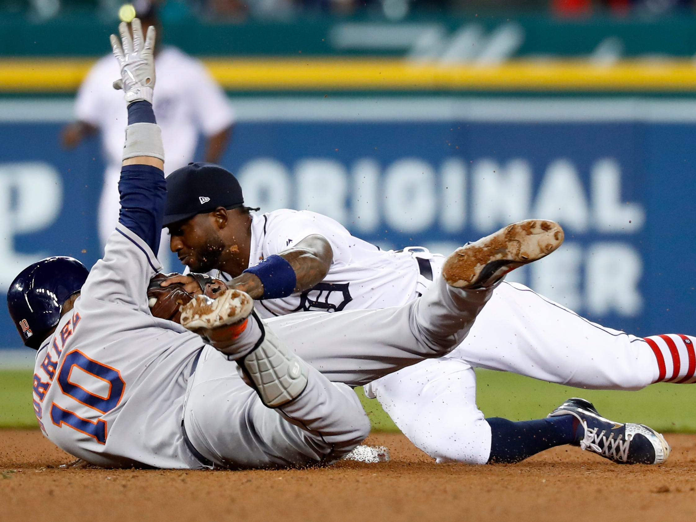 Detroit Tigers shortstop Niko Goodrum (28) tags Houston Astros' Yuli Gurriel (10) out at second base in the ninth inning of a baseball game in Detroit, Tuesday, Sept. 11, 2018.