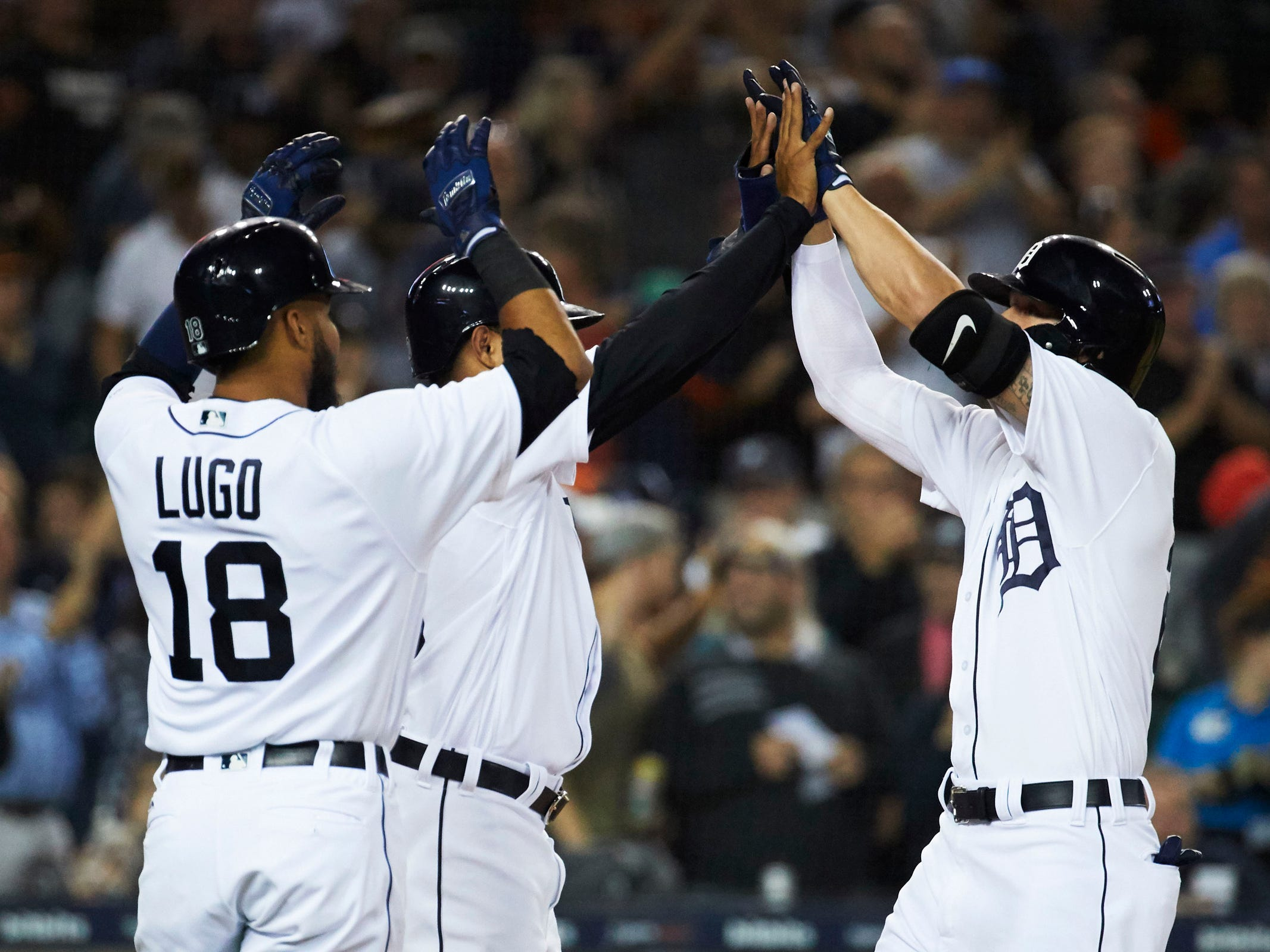 Detroit Tigers center fielder JaCoby Jones (21) receives congratulations from  second baseman Dawel Lugo (18) and first baseman Ronny Rodriguez (60) after he hits a three run home run in the fourth inning against the Houston Astros at Comerica Park, Tuesday, Sept. 11, 2018.