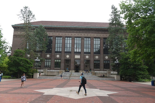 (file) Students walk through the Diag in front of the Hatcher Graduate Library on the campus of the University of Michigan campus on June 27, 2018.