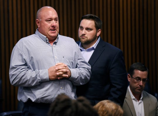 Curt Vogel, left, who was with David Snell on I-75 when he was struck and killed by Samiya Speed, is consoled by Snell's son T.J. Rancour during his victim impact statement.
