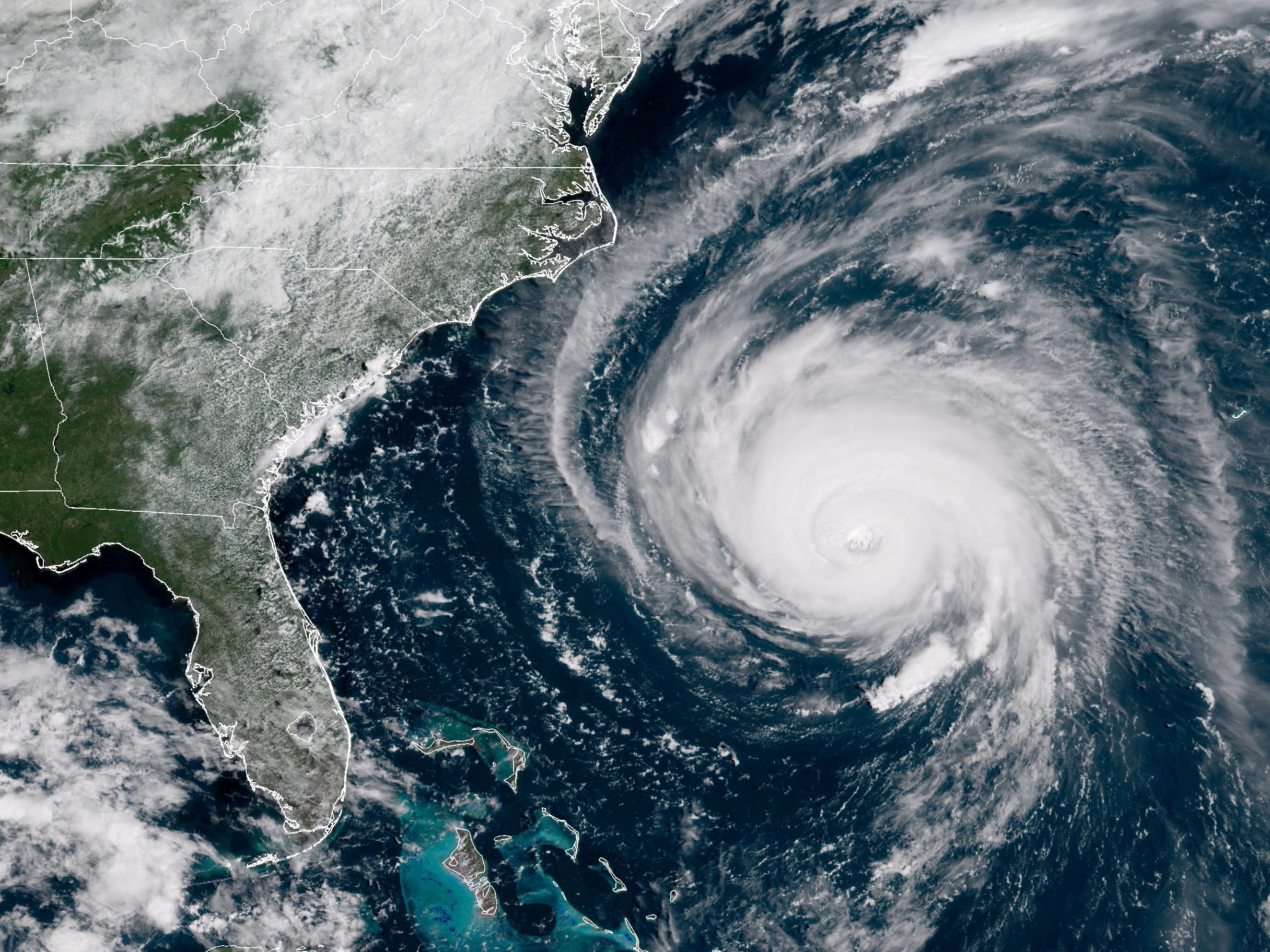 In this satellite image provided by U.S. National Oceanic and Atmospheric Administration (NOAA), Hurricane Florence churns through the Atlantic Ocean toward the U.S. East Coast on September 12, 2018. Florence slowed its approach to the U.S. today and was forecast to turn south, stalling along the  North Carolina and South Carolina coast and bringing with it torrential rain, high winds and a dangerous storm surge tomorrow through Saturday.