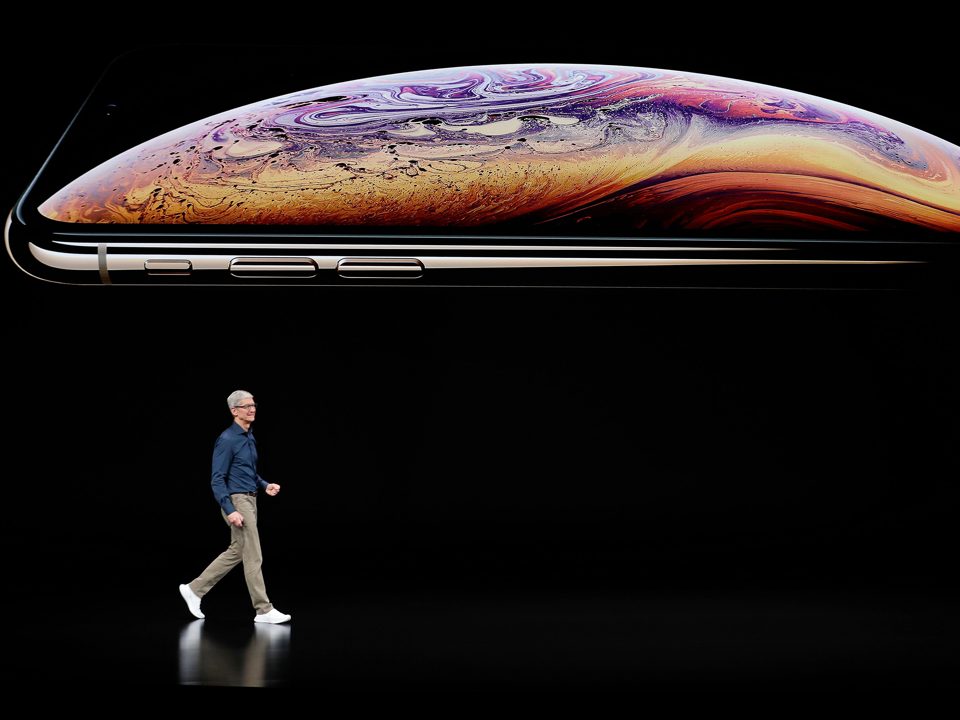 Apple CEO Tim Cook speaks about the Apple iPhone XS at the Steve Jobs Theater during an event to announce new Apple products Wednesday, Sept. 12, 2018, in Cupertino, Calif.