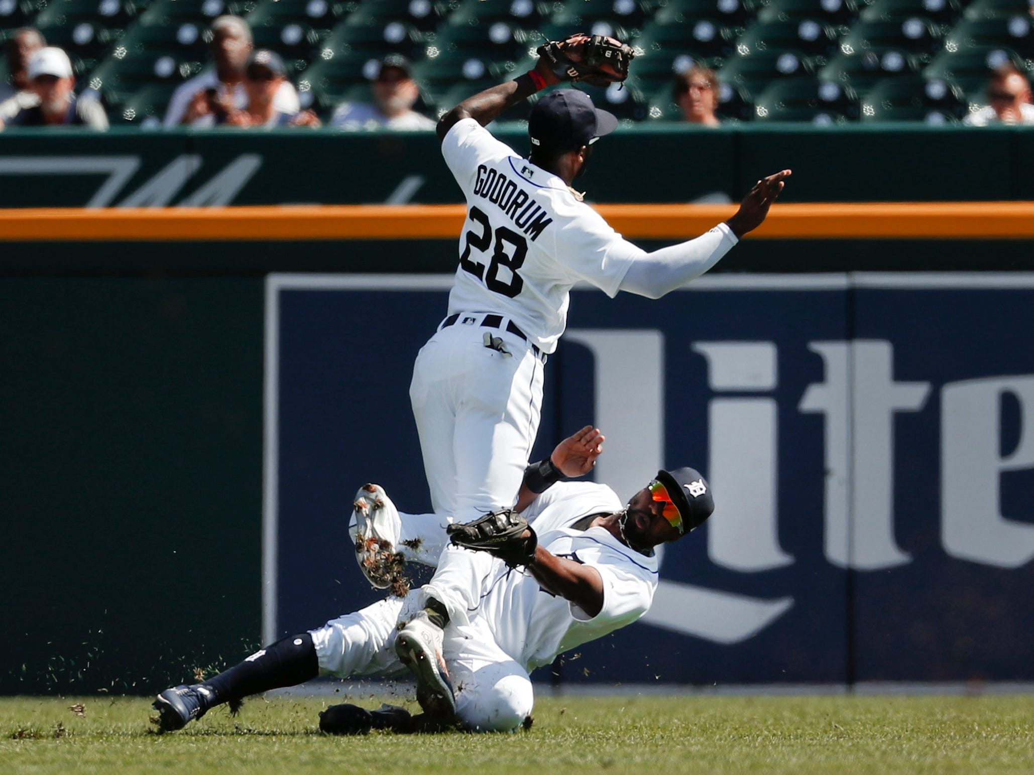Detroit Tigers left fielder Christin Stewart, bottom, makes the catch on a Houston Astros' Evan Gattis fly ball as shortstop Niko Goodrum (28) collides with him in the second inning.