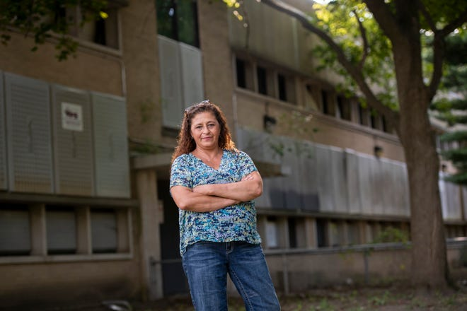 Lisa Bednarz, president of the Mortenson Grand River Home Association, stands on the property of the former Lodge elementary school, in Detroit, September 12, 2018. Bednarz hopes to get the school and its field renovated for the neighborhood to use.