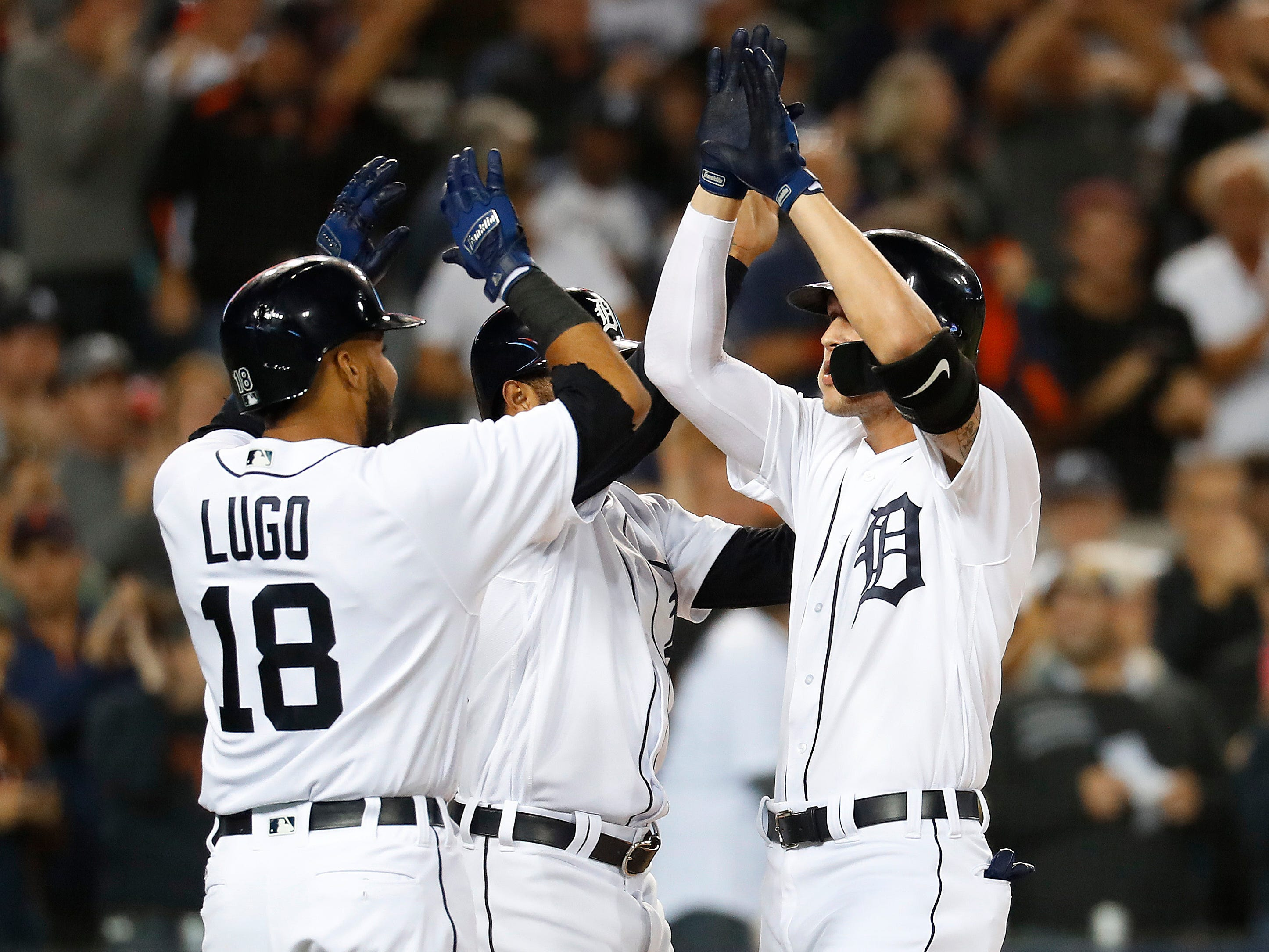 Detroit Tigers' JaCoby Jones, right, celebrates his three-run home run with Dawel Lugo (18) and Ronny Rodriguez in the fourth inning.