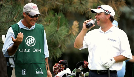 Brian Bateman shares a laugh with his caddie before he tees off on the 15th hole at the Buick Open. He won in 2008.