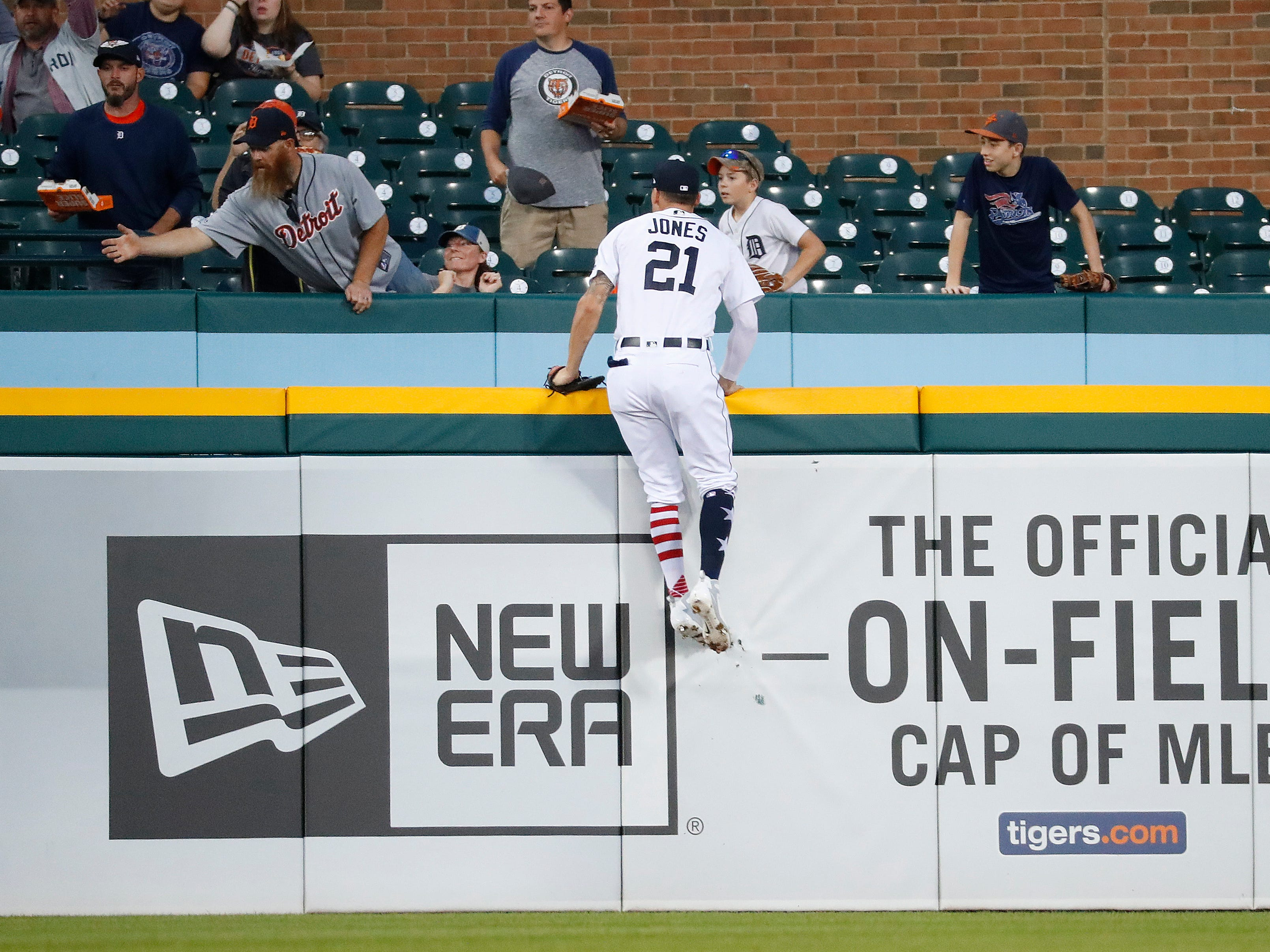 Detroit Tigers left fielder JaCoby Jones climbs the outfield wall but can't reach a Houston Astros' Tyler White two-run home run in the fourth inning.