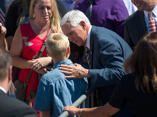 Vice President Mike Pence greets the public at Gerald R. Ford International Airport in Grand Rapids, Mich. on Wednesday, Sept. 12, 2018. Pence is visiting Grand Rapids to pay his respects to the DeVos family, and also tour Mill Steel Company and discuss President Trump's tax reform policies on Michigan businesses.
