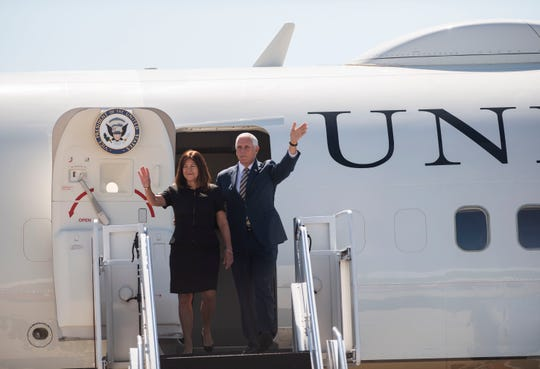 Vice President Mike Pence waves with his wife, Karen Pence, to those welcoming him at Gerald R. Ford International Airport in Grand Rapids, Mich. on Wednesday, Sept. 12, 2018. Pence is visiting Grand Rapids to pay his respects to the DeVos family, and also tour Mill Steel Company and discuss President Trump's tax reform policies on Michigan businesses.