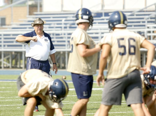Elmira Notre Dame head coach Mike D'Aloisio talks to his players during practice Aug. 24 at Brewer Memorial Stadium.