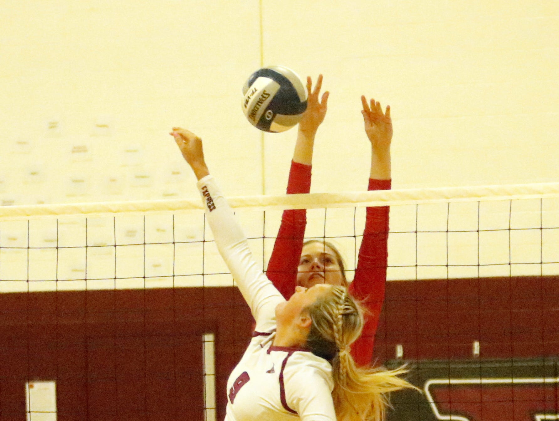 Sara Zepkowski of Owego goes up for a block against Mackenna Bruner of Elmira on Sept. 11, 2018 at Elmira High School.