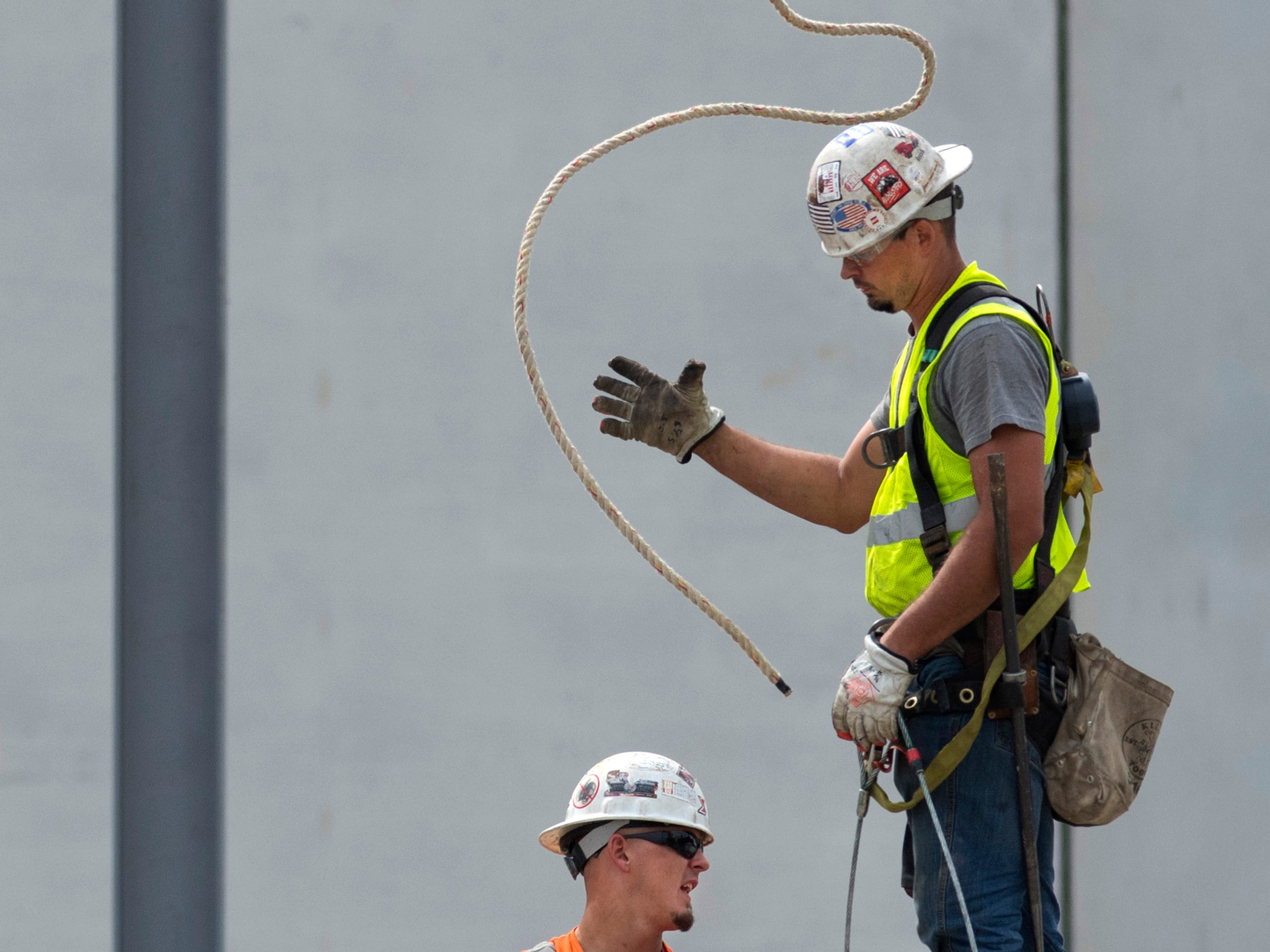 Brothers Seth Callaway, left, and Adam Callaway install steel beams at the under-construction St. Vincent Evansville YMCA in Downtown Evansville Wednesday afternoon. Skanska is in charge of the build of the 10,000 square-foot project that is on target to be completed in August of 2019. The area where the beams are being assembled will include a training kitchen, multi-purpose room and various other work spaces.
