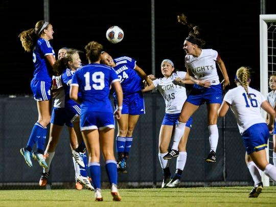The Castle Knights block Memorial's Olivia Schitter (24) and the rest of the Memorial Tigers from making a goal after a Memorial corner kick with seconds left in the game at Traylor Family Stadium in Evansville, Ind., Tuesday, Sept. 11, 2018. The Knights remain undefeated after a 2-1 victory over the Tigers.