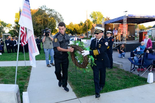 First responders place a wreath during a ceremony in Gibsonburg to remember the victims of the Sept. 11, 2001 terrorist attacks.
