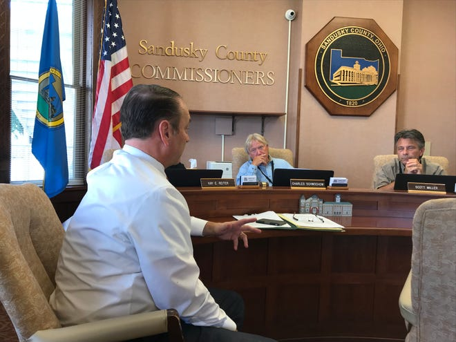 Greg Talecky, a client representative from Poggemeyer Design Firm, discusses with Sandusky County Commissioners the ongoing audits of county buildings scheduled for energy-efficiency upgrades.